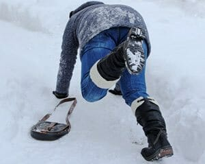 A person experiences a slip and fall accident in the snow on Long Island