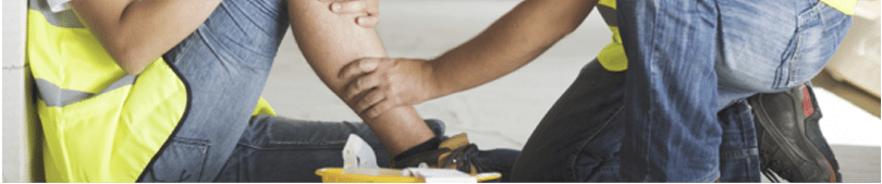A worker tends to an injured coworker's leg