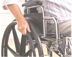 An injured man in a wheelchair on his way to meet with a New York personal injury lawyer