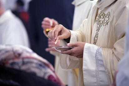 A priest in the Catholic Church who may be aware of abuse by clergy