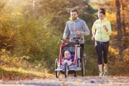 A young family jogging with a stroller similar to the one target by the CPSC in their recent BOB stroller recall lawsuit.