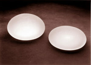 Two textured breast implants