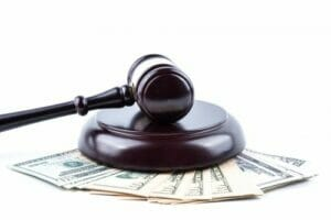 Zantac lawsuit settlement money and a gavel