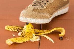 A person steps on a banana peel